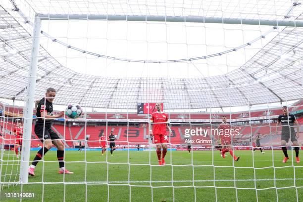 Florian Wirtz of Bayer 04 Leverkusen scores their side's first goal during the Bundesliga match between Bayer 04 Leverkusen and 1. FC Union Berlin at...
