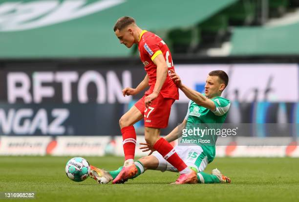 Florian Wirtz of Bayer Leverkusen battles for possession with Maximilian Eggestein of Werder Bremen during the Bundesliga match between SV Werder...