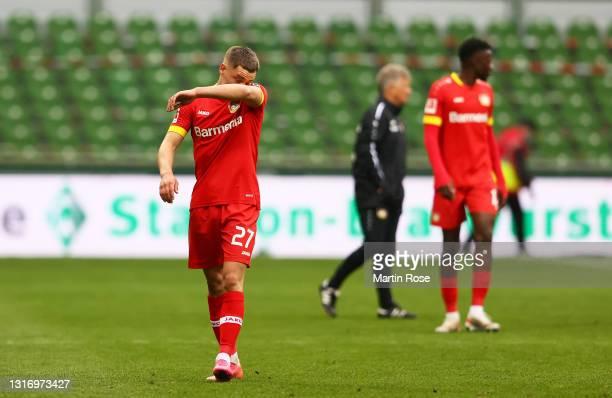 Florian Wirtz of Bayer Leverkusen looks dejected following the Bundesliga match between SV Werder Bremen and Bayer 04 Leverkusen at Wohninvest...