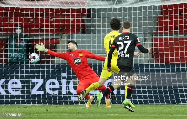 Florian Wirtz of Bayern 04 Leverkusen scores their sides second goal past Roman Burki of Borussia Dortmund during the Bundesliga match between Bayer...