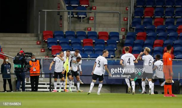 Florian Wirtz of Germany celebrates with Salih Ozcan and Lukas Nmecha after scoring their side's first goal during the 2021 UEFA European Under-21...