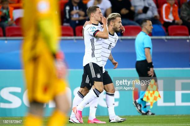 Florian Wirtz of Germany U21 celebrates with Niklas Dorsch of Germany U21 after scoring his sides second goal during the 2021 UEFA European Under-21...