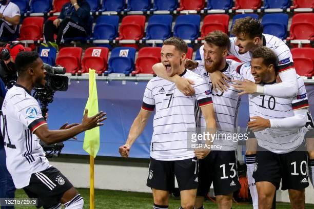 Florian Wirtz of Germany U21 celebrates with Salih Ozcan of Germany U21, Mergim Berisha of Germany U21 and Lukas Nmecha of Germany U21 after scoring...