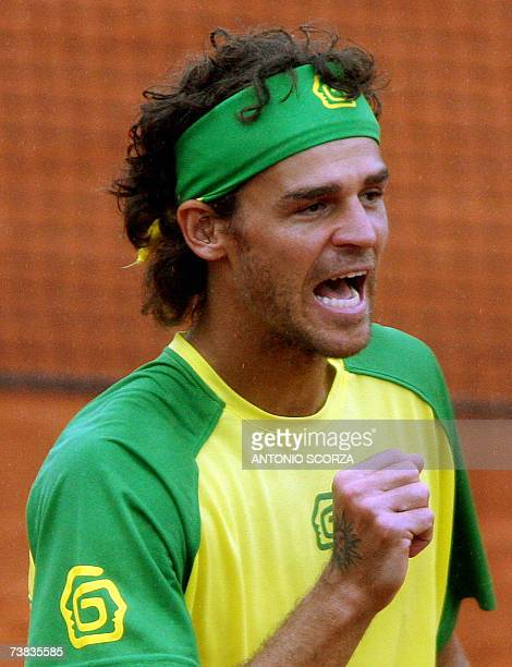 Brazilian tennis player Gustavo Kuerten playing with Andre Sa celebrates after scoring a point against Canadians Daniel Nestor and Frederic Niemeyer...