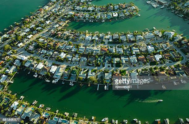 usa, florida, aerial of housing along the tampa bay coastline in saint petersburg - st. petersburg florida stock photos and pictures