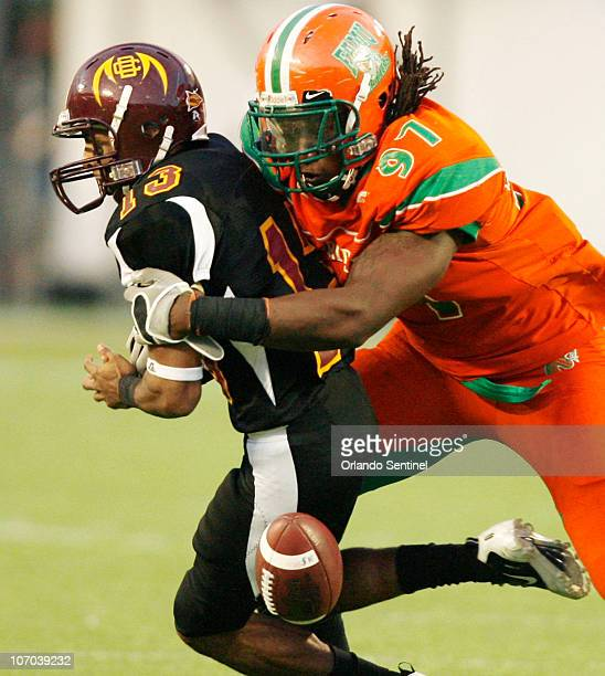 Florida AM defensive end Kendrick Washington knocks the ball out of the hands of BethuneCookman quarterback Matt Johnson during the Florida Classic...