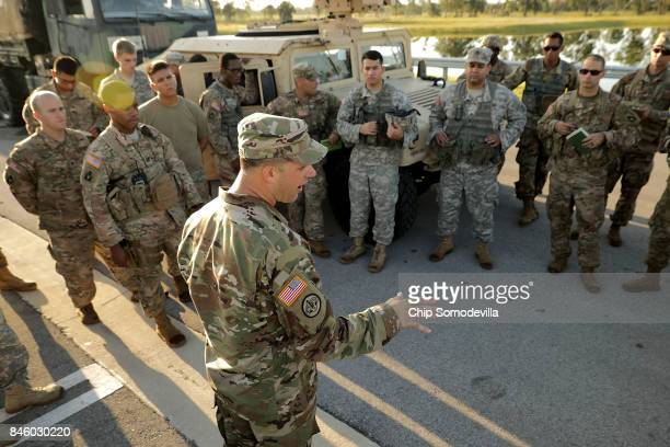 Florida Army National Guard 1st Sgt Jeremy Commander address troops from Delta Company 1st Battallion 124th Infantry 53rd Infantry Brigade Combat...