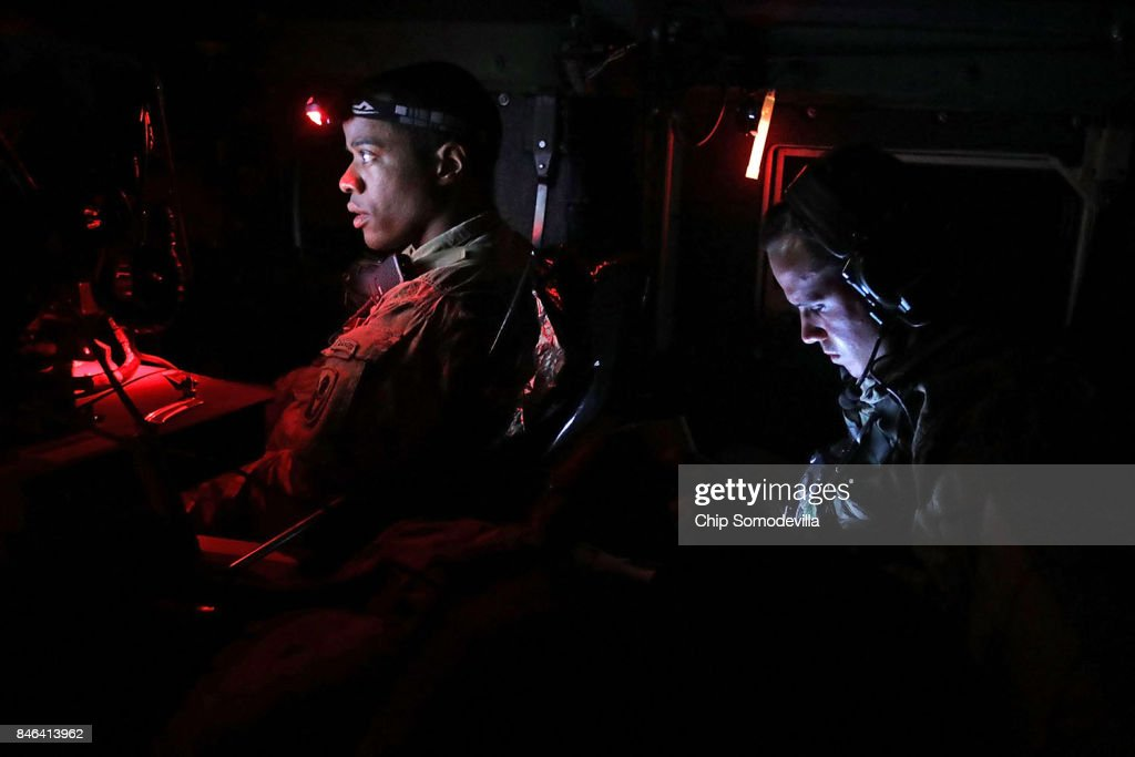 Florida Army National Guard Captain Adam Cockrell (L) and Private First Class Daniel Jimenez from Delta Company, 1st Battallion, 124th Infantry, 53rd Infantry Brigade Combat Team keep track of their mission during an overnight patrol two days after Hurricane Irma slammed into the state on September 12, 2017 in Key West, Florida. Working in conjunction with the sheriff's department, the guardsmen traveled up and down the Keys all night to deter looting and to make safety checks on residents. The Federal Emergency Managment Agency has reported that 25-percent of all homes in the Florida Keys were destroyed and 65-percent sustained major damage when they took a direct hit from Hurricane Irma.