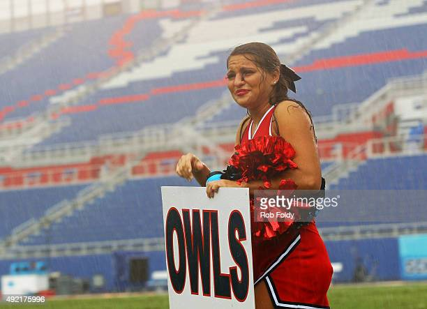 Florida Atlantic Owls cheerleader leaves the field after a weather delay was called during the fourth quarter of the game against the Rice Owls at...