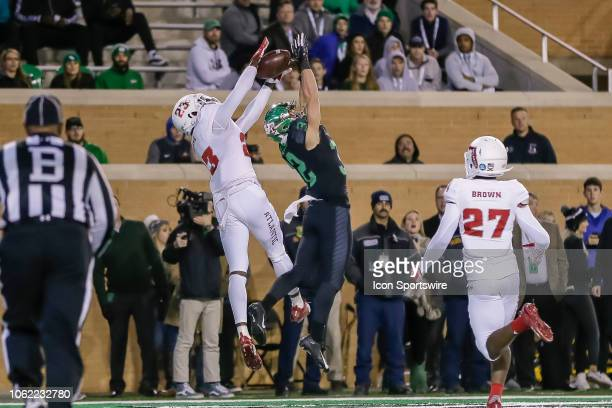 Florida Atlantic Owls cornerback James Pierre and North Texas Mean Green wide receiver Michael Lawrence go up for the football during the game...