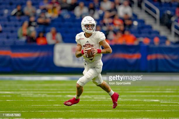 Florida Atlantic Owls quarterback Chris Robison runs out of the pocket during the game between the Florida Atlantic Owls and the UTSA Roadrunners on...