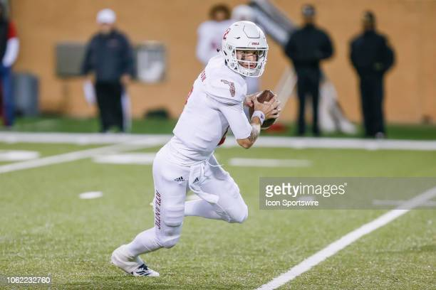 Florida Atlantic Owls quarterback Chris Robison scrambles out of the pocket during the game between the North Texas Mean Green and the Florida...