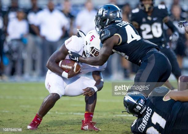 Florida Atlantic Owls running back Devin Singletary gets tackled during the football game between UCF and FAU on September 21 2018 at CFE Arena in...