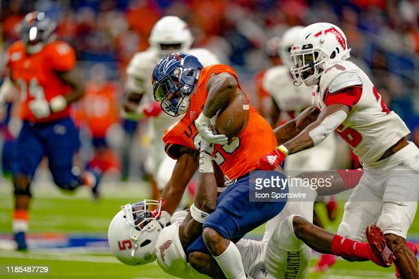 Florida Atlantic Owls safety Ahman Ross knocks the ball out of the grasp of UTSA Roadrunners running back Sincere McCormick during the game between...