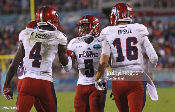 Florida Atlantic running back Devin Singletary celebrates his touchdown in the second quarter with quarterback Jason Driskel and wide receiver Kalib...
