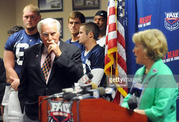 Florida Atlantic University head football coach Howard Schnellenberger left waits to speak at a news conference to announce that he will retire from...