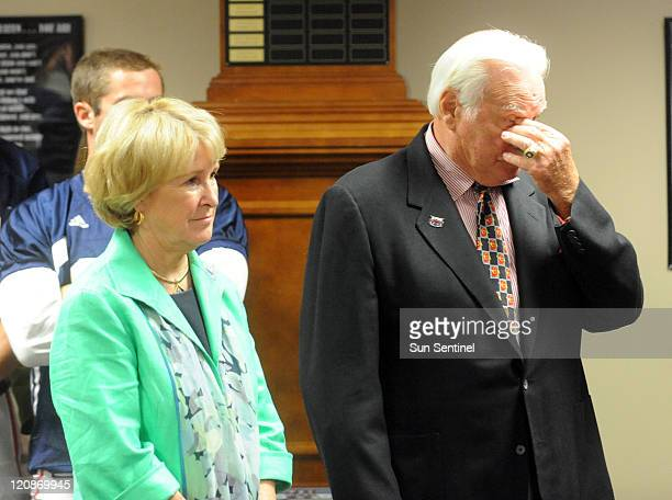 Florida Atlantic University head football coach Howard Schnellenberger right takes a moment at his news conference to announce that he will retire...