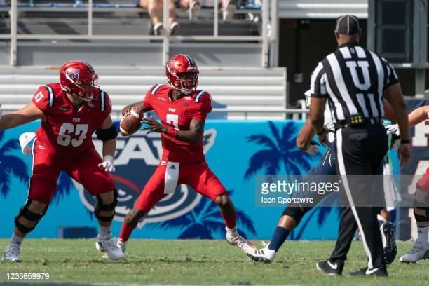 Florida Atlantic University quarterback NKosi Perry passes the ball as the Florida Atlantic University Owls compete against the Florida International...