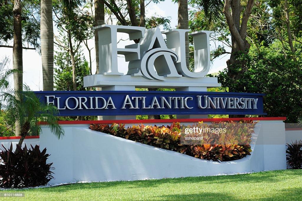 Florida Atlantic University sign among palm trees : Stock Photo