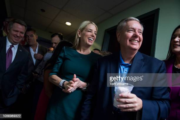 Florida Attorney General Pam Bondi and Sen Lindsey Graham RSC attend a rally with Florida governor candidate Rep Ron DeSantis RFla and other GOP...