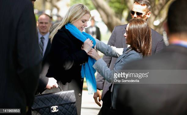 Florida Attorney General Pam Bondi gets help with her scarf before a news conference about the Supreme Court's second day of hearings on the...