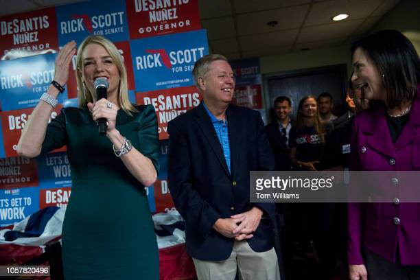 Florida Attorney General Pam Bondi left Sen Lindsey Graham RSC and Florida State Sen Dana Young attend a rally with Florida governor candidate Rep...