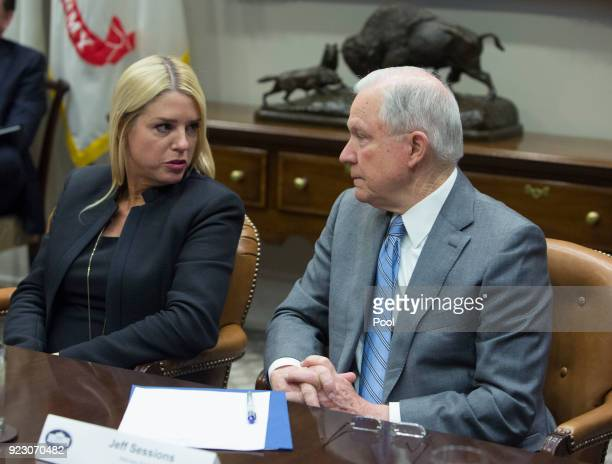 Florida Attorney General Pam Bondi speaks with United States Attorney General Jeff Sessions during a meeting with state and local officials on school...