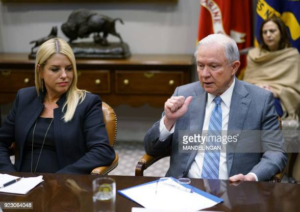 Florida Attorney General Pam Bondi watches as US Attorney General Jeff Sessions speaks during a meeting with state and local officials on school...
