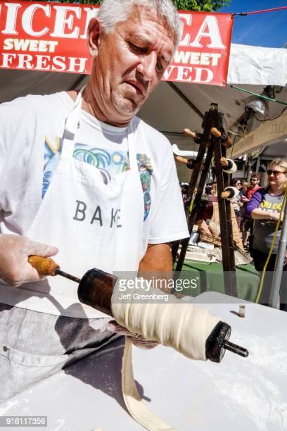 Florida Carnaval Miami Food Vendor making chimney cake
