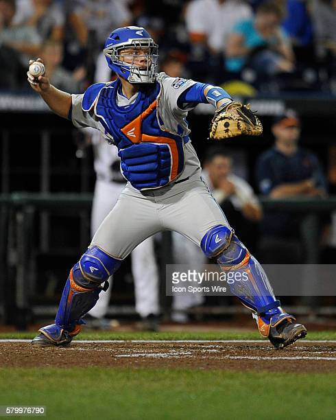 Florida catcher J.J. Schwartz throws to second base during the College World Series game between the Virginia Cavaliers and the Florida Gators at TD...