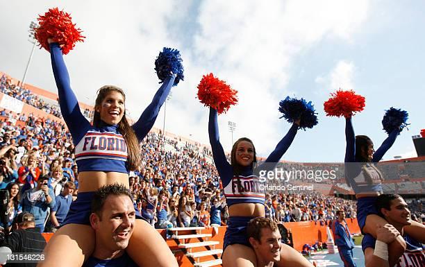 Florida cheerleaders celebrate the Gators' victory over Vanderbilt at Ben Hill Griffin Stadium in Gainesville Florida Saturday November 5 2011 The...