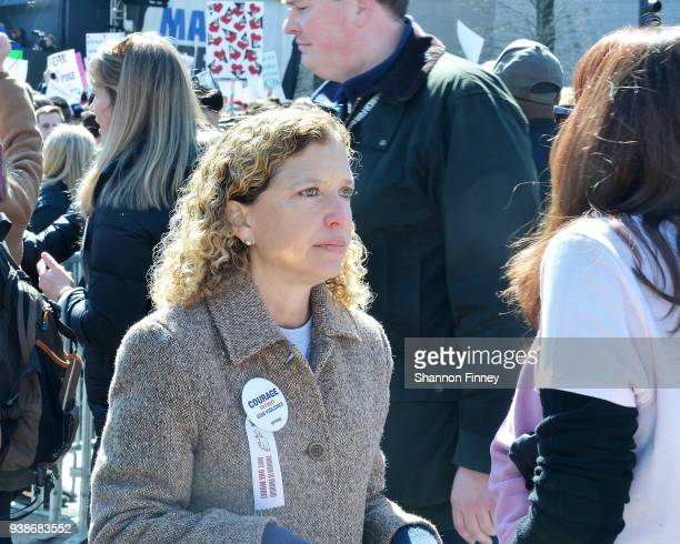 Florida Congresswoman Debbie Wasserman Schultz speaks to a woman attending the March for Our Lives Rally on March 24 2018 in Washington DC