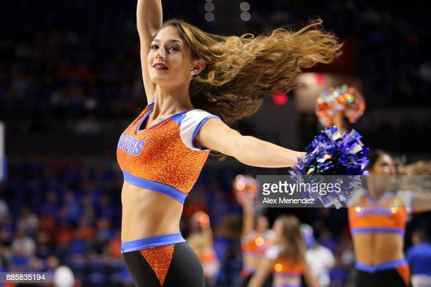 Florida dancer performs during a NCAA basketball game between the Florida State Seminoles and the Florida Gators at the Stephen C O' Connell Center...