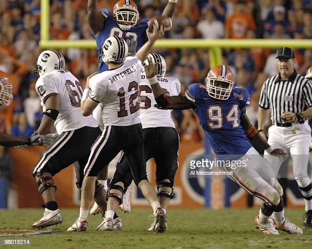 Florida defenders pressure South Carolina quarterback Blake Mitchell on November 11 2006 in Gainesville Florida won 17 16