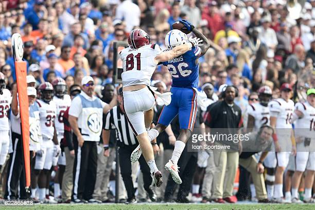 Florida defensive back Marcell Harris leaps up to intercept a pass in front of South Carolina tight end Hayden Hurst during an NCAA football game...