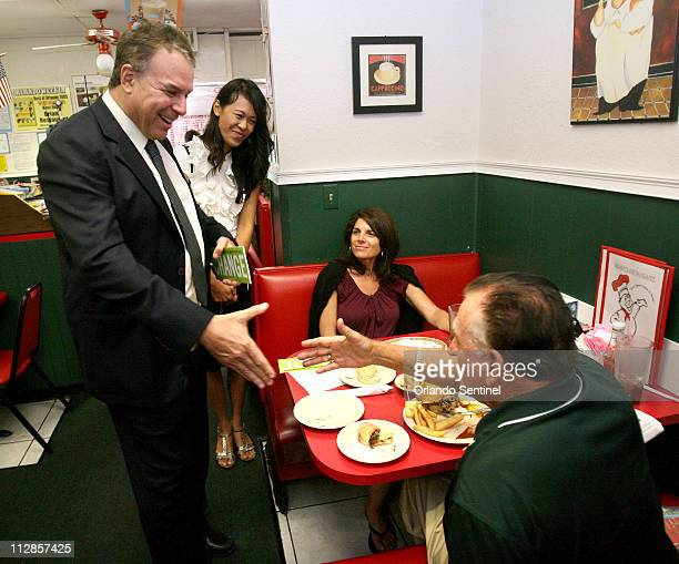 Florida Democratic candidate for the US Senate Jeff Greene greets diners Lee Chira right and his daughter Michelle Carlton at Brian's Restaurant in...
