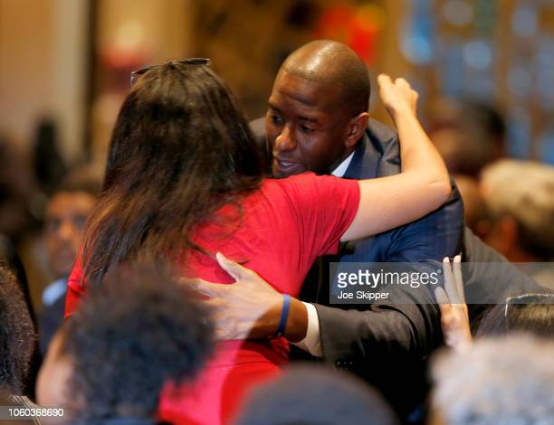 Florida Democratic gubernatorial candidate Andrew Gillum hugs a guest as he attends a service to advocate for a vote recount at the New Mount Olive...