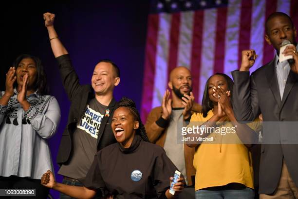 Florida Democratic gubernatorial candidate Andrew Gillum is joined by his wife R Jai Gillum rapper Common Rep Carlos Smith and other supporters at a...