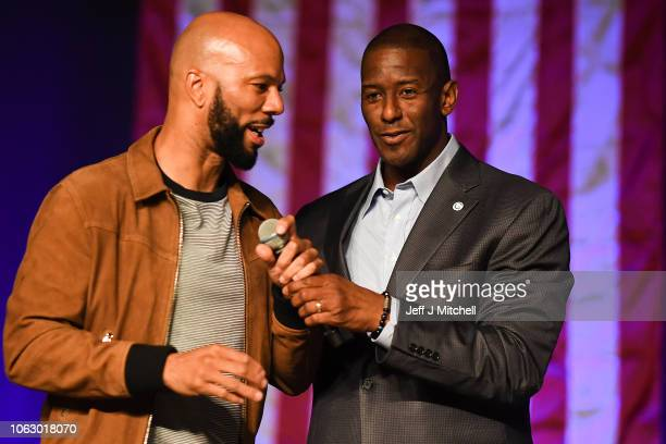 Florida Democratic gubernatorial candidate Andrew Gillum is joined on stage by rapper Common as they attend a campaign rally at the CFE arena on...