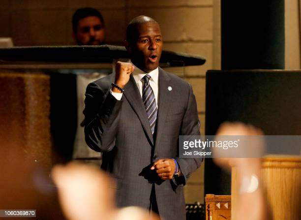 Florida Democratic gubernatorial candidate Andrew Gillum reacts to applause as he attended a service to advocate for a vote recount at the New Mount...