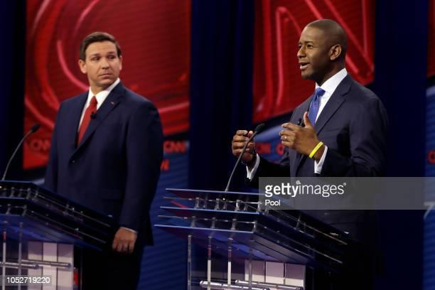Florida Democratic gubernatorial candidate Andrew Gillum right speaks as Republican gubernatorial candidate Ron DeSantis looks on during a CNN debate...