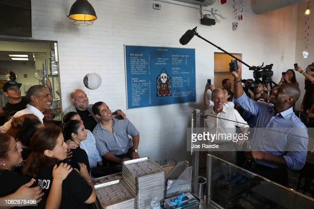 Florida Democratic gubernatorial candidate Andrew Gillum takes a photograph of former US President Barack Obama posing with restaurant workers as US...