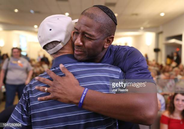 Florida Democratic gubernatorial nominee Andrew Gillum hugs a wellwisher at a political event at the Century Pines Jewish Center on October 18 2018...
