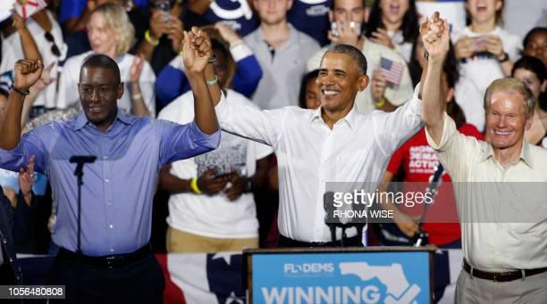 Florida Democratic gubernatorial nominee Andrew Gillum President Barack Obama and Senator Bill Nelson hold hands as they addresses the media and...