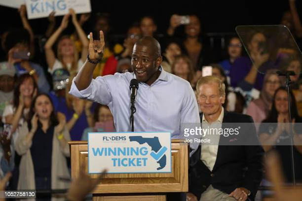 Florida Democratic gubernatorial nominee Andrew Gillum speaks as US Sen Bill Nelson listens behind him during a campaign rally held at the University...