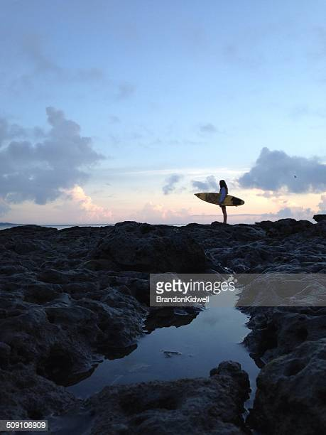 USA, Florida, Duval County, Jacksonville Beach, Side view of woman holding surfboard on beach