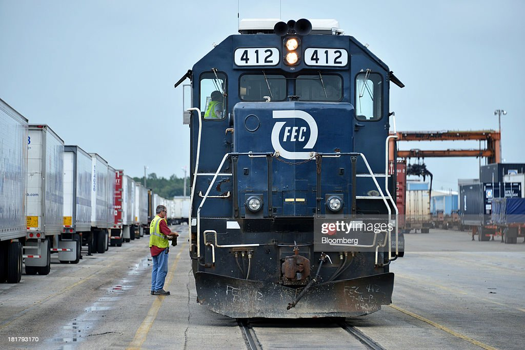 A Florida East Coast Railway (FEC) locomotive prepares to 'build' a container train in the railway's Bowden Yard in Jacksonville, Florida, U.S., on Monday Sept. 23, 2013. The FEC is a 351-mile freight rail system along the east coast of Florida, connecting the ports of Miami, Fort Lauderdale and Palm Beach, which transports intermodal shipments, provides carload service and moves commodities, automobiles, bulk liquids, building materials, orange juice and electronics. Photographer: Mark Elias/Bloomberg via Getty Images