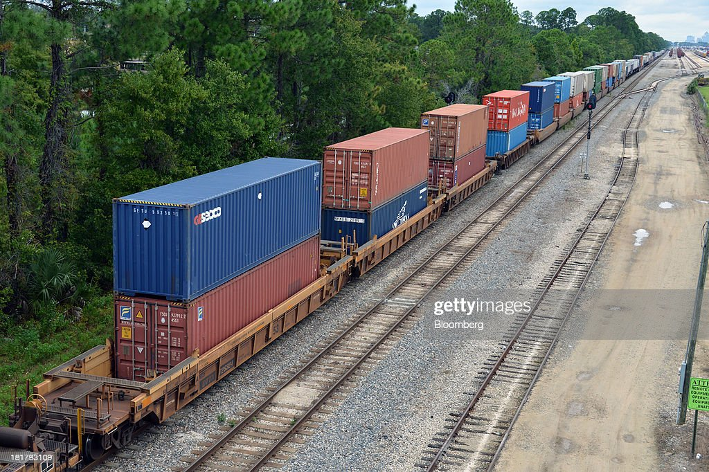 A Florida East Coast Railway (FEC) train with double stack container cars departs the railway's Bowden Yard in Jacksonville, Florida, U.S., on Monday Sept. 23, 2013. The FEC is a 351-mile freight rail system along the east coast of Florida, connecting the ports of Miami, Fort Lauderdale and Palm Beach, which transports intermodal shipments, provides carload service and moves commodities, automobiles, bulk liquids, building materials, orange juice and electronics. Photographer: Mark Elias/Bloomberg via Getty Images
