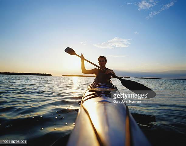 USA, Florida, Everglades, man kayaking, sunset