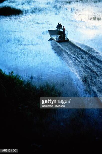 USA, Florida, Everglades Nat. Park, tourists on airboat ride, elevated